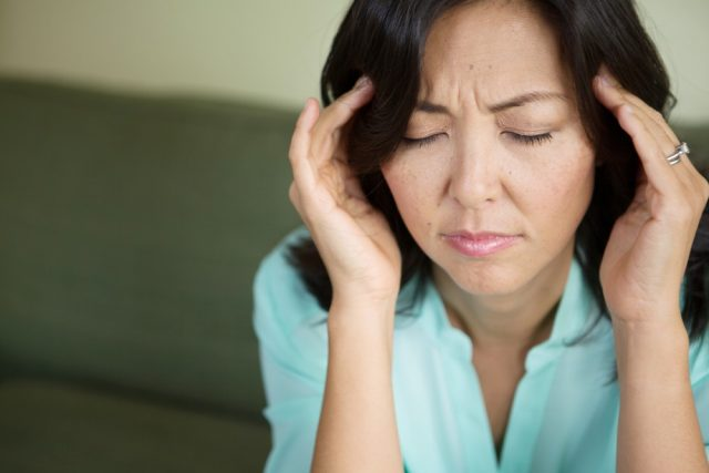 Premenopause: Woman with a headache