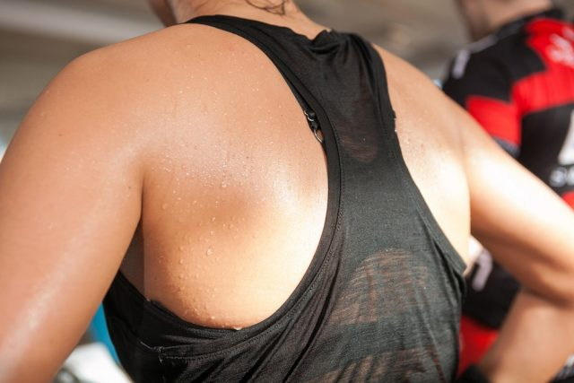 sweat skin of a woman's back