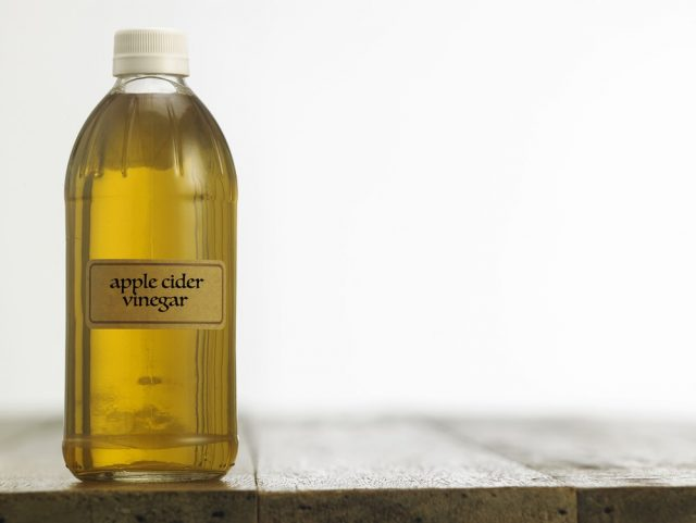 Bottle of clear filtered Apple Cider Vinegar