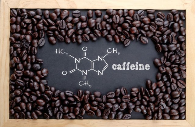 Caffeine chemical formula on chalkboard with coffee beans