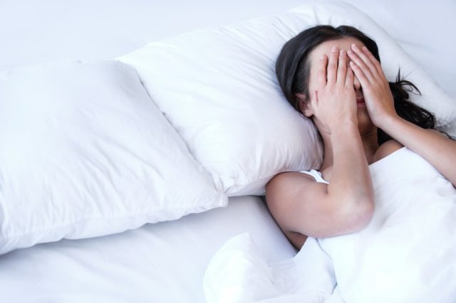 Loss of sleep: Depressed women in bed