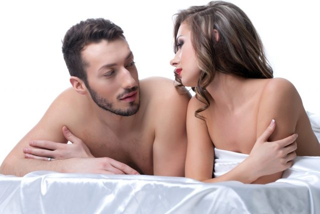 Handsome lovers talking in bed after sex