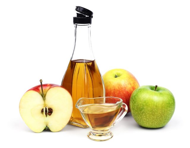 full bottle and cup of Apple cider vinegar