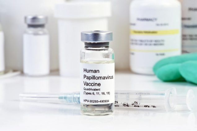 Human Papilloma Virus vaccine with syringe and vial at a clinic.